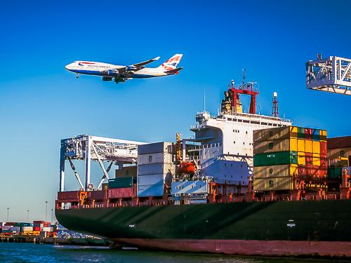 Plane over Cargo Container ship